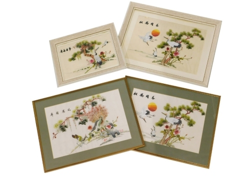 Four Chinese silk embroidered pictures, each depicting trees, flowering plants, birds in flight, etc., various sizes. (4)