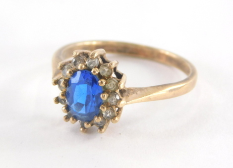 A 9ct gold floral cluster ring, set with central blue paste stone, surrounded by cz, each in claw setting, ring size O, 2.4g all in.