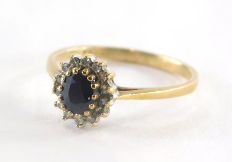 A 9ct gold cluster ring, set with central oval cut sapphire, surrounded by cz, in raised claw setting with pierced shank, ring size I, 1.6g all in.