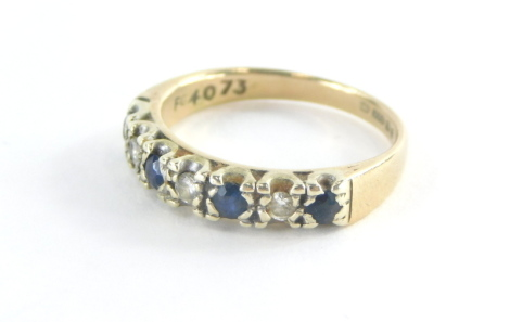 A 9ct gold half hoop eternity ring, set with four sapphires and three tiny diamonds, in a platinum setting, ring size L, 2.5g all in. (misshapen)