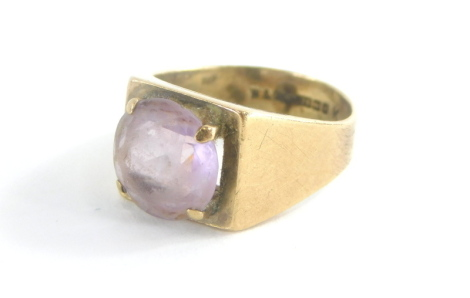A 9ct gold signet ring, the rectangular shield set with amethyst in four claw setting, on a plain band, ring size L½, 4.5g all in.