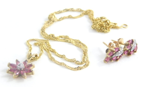 A 9ct gold ruby and diamond necklace and earring set, set with rubies and diamonds, the floral cluster pendant with central ball of tiny diamonds 2cm high, on a 9ct gold chain, approx. 35cm long, together with a pair of associated earrings with butterfly