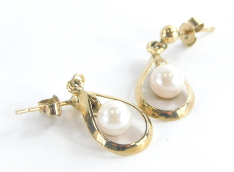 A pair of 9ct gold drop earrings, each drop with tear drop loop with central pearl lustre bead, on butterfly backs the earrings 2cm drop, 1.6g all in.