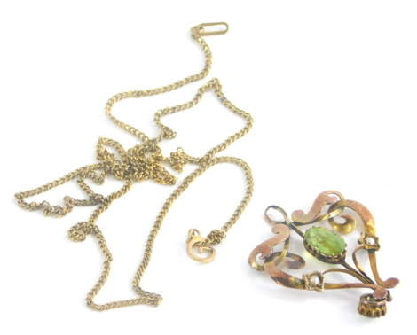 An Art Nouveau pendant and chain, the Art Nouveau pendant set with central oval cut peridot, and set with seed pearls, in yellow metal back stamped 9ct, on a fine link 9ct gold chain, the pendant 3cm high, the chain approx. 40cm long, 3.2g all in.