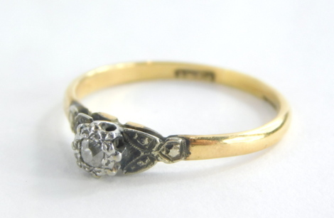 A diamond dress ring, with central illusion set tiny diamond, with V splayed platinum shoulders on a yellow metal band stamped 18ct, ring size R, 2.3g all in.
