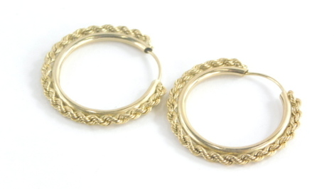 A pair of 9ct gold hoop earrings, each with outer twist design on a plain inner band, 2cm diameter, 1.6g all in.