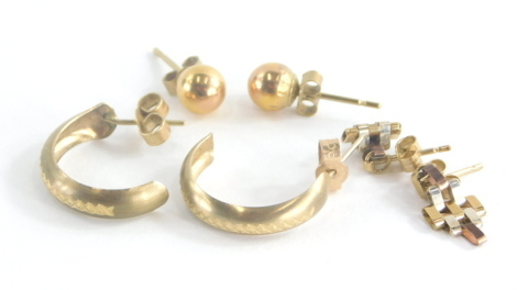 A group of 9ct gold and other earrings, to include a pair of 9ct gold ball studs with butterfly backs, a pair of 9ct gold etched design hoops and a pair of bi-colour 9ct gold drop earrings, three pairs, 2.7g all in.