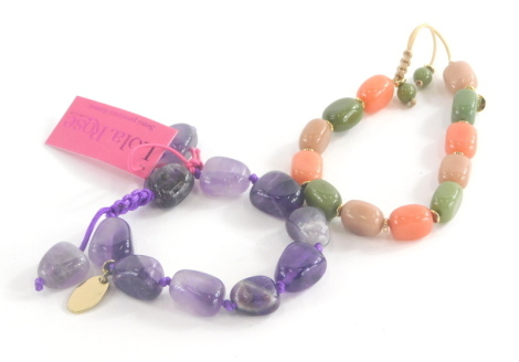 Two items of Lola Rose jewellery, to include an amethyst coloured bracelet and a green and pink stoned bracelet, in presentation sleeves. (2)