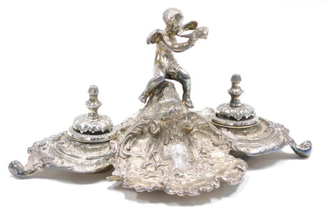 A Jordan Collection Sheffield silver plated inkstand, mounted with a putto blowing a horn, the rococo scroll base with two wells, each with a liner and cover, on shaped feet, impressed mark to underside, 27cm long.