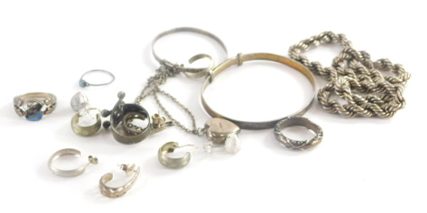 A group of silver and other jewellery, to include silver bangles, hoop earrings, rope twist necklaces etc. (quantity)