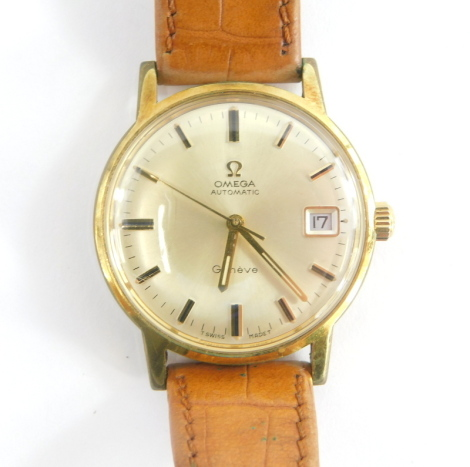 An Omega Geneve automatic gentleman's wristwatch, in a gold plated and stainless steel case, with inscription 'in appreciation for long service for D. Newbold 1971', on a tan leather strap, boxed.
