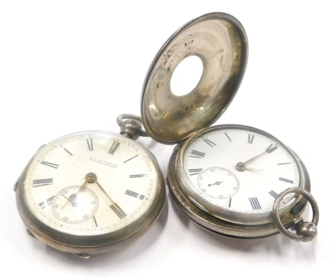 An early 20thC silver half hunter pocket watch, with blue enamel numerals, and a silver pocket watch, the dial stamped Swinburn Workington.