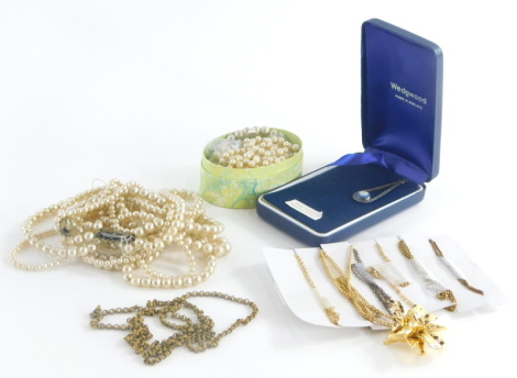 A group of various costume jewellery, faux pearl necklaces, gold plated bracelets, a Wedgwood pendant, etc. (1 box)