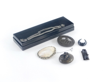 A group of costume jewellery, to include a carved malachite oval brooch lacking back pin, a Victorian style memorial pendant, with grouse and reed detailing, a mother of pearl brooch, silver plated chain, loose jet, etc. (a quantity)
