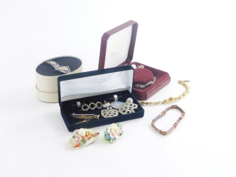 A group of costume jewellery and effects, to include porcelain brooches, silver charm bracelet, silver filigree design bracelet, modern bracelets, etc. (a quantity)