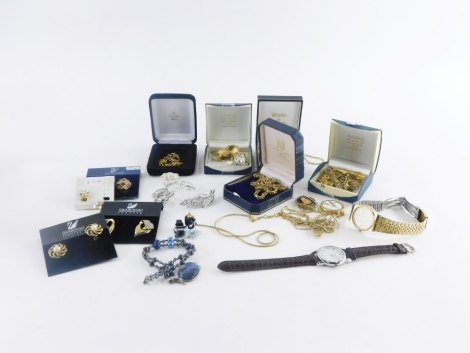 A group of modern costume jewellery and effects, wristwatches empty boxes, gold plated necklaces, cuff links, dress rings etc. (1 tray)