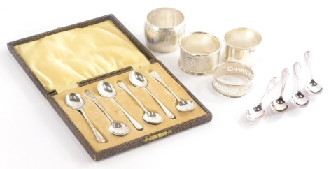 A collection of small silver, to include three silver napkin rings, one with engine turned decoration and R initial in a shaped cartouche, various silver spoons, etc., weighable silver 1½oz.