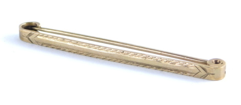 A 9ct gold tie pin, of plain form with plain pin back, 5cm wide, 2.3g.