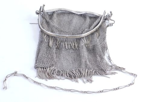 A mid 20thC Art Deco chain mail evening purse, with paperclip hanger, 15cm wide, unmarked white metal. (AF)