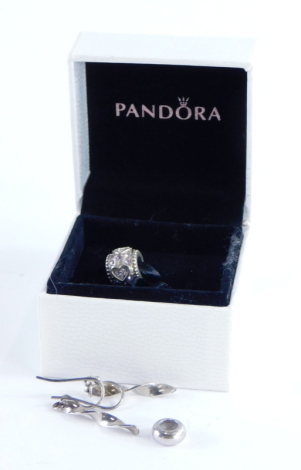 A group of Pandora and other jewellery, to include a Pandora silver breaker, a Pandora silver and pink stone set heart charm and a pair of silver drop earrings. (3)
