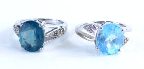 Two Gemporia silver dress rings, to include a Tuscan green fluorite and white topaz stone silver ring, and a sky blue topaz and white zircon sterling silver ring, each with certificate, 8.2g all in.