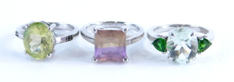 Three Gemporia silver dress rings, to include citron feldspar and champagne diamond dress ring, a Prasiolite and Chrome Diopside ring, together with a Anahi Ametrine sterling silver ring, 10.8g all in. (3)