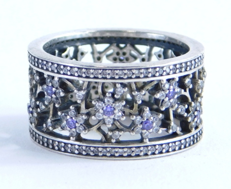 A silver amethyst and cz set Pandora dress ring, of Forget Me Not design set with amethyst and cz stones, in pierced detailing, ring size P, boxed, 7.1g all in.