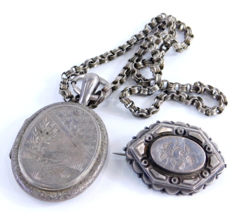 Two items of silver jewellery, to include a Victorian silver floral engraved brooch, a silver engraved stork locket pendant on a silver plated chain, 21.5g all in. (2)