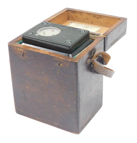 A Skymaster Ghost High Speed pigeon timing clock, in a green Bakelite case, serial number A5267, the outer pine fitted carrying case, with labels for Edward Wilkinson of Pocklington and Body and Ridewood of Scarborough, 16cm high, 12cm wide.