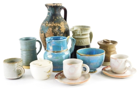 A collection of studio pottery, to include a two colour jug, jar and cover, various coffee cups, etc., bearing various signatures and stamps. (1 tray)