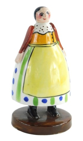 A Crown Staffordshire pottery Folk Art figure, with green stamp and impressed mark to under side, 13cm high.