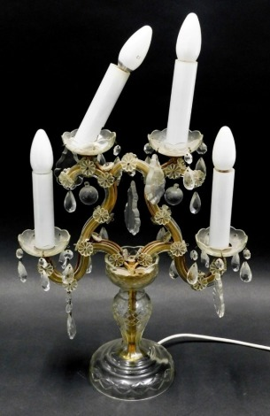 A continental glass four branch light fitting, decorated with various moulded glass flowers and droplets, 44cm high.