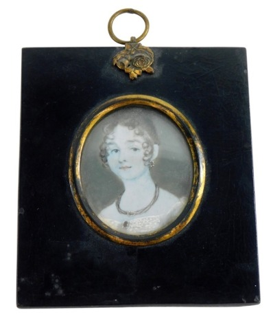 An early 19thC portrait miniature of a lady on ivory, in a black frame with gilt highlights, 7cm x 5½cm.