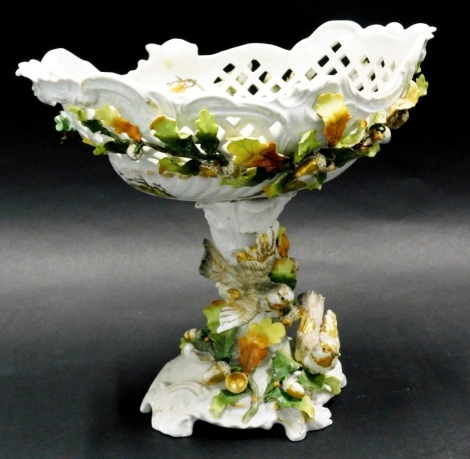 A late 19thC Sitzendorf two handled pedestal bowl, the bowl with pierced decoration, and decorated with leaves, acorns, etc., the base decorated with birds, leaves, acorns, etc. 28cm high.