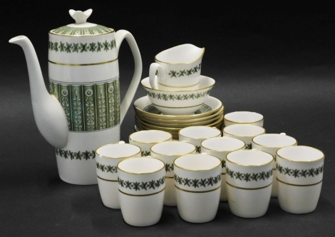 A Spode Provence pattern part coffee service, pattern number Y7843, on a white ground decorated with green flowers, leaves, etc., with gilt highlights.
