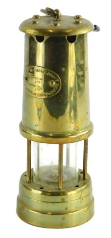 A Lamp and Lime light Company Hockley brass miners lamp, the plaque stating colliery number 8721 serial number 6107, 22cm high.