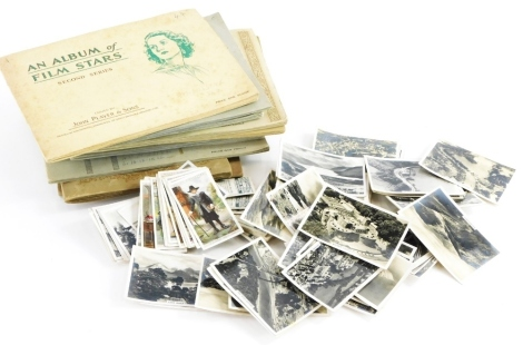 A collection of cigarette cards, some loose, to include WD and HO Wills, John Player and Sons, etc. (a quantity)