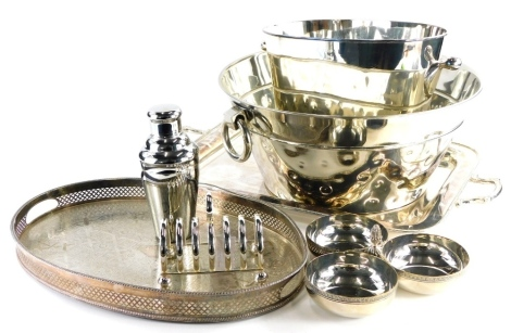 A collection of silver plated wares, to include a two handled tray, 49cm x 38cm, a six division toast rack, cocktail shaker, three division hors d' oeuvres dish, wine bucket, etc. (a quantity)