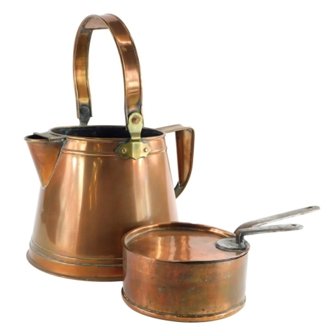 An early 20thC copper watering type can, with brass mounts, and a 19thC copper pan, with lid, indistinctly initialled to lid. (2)