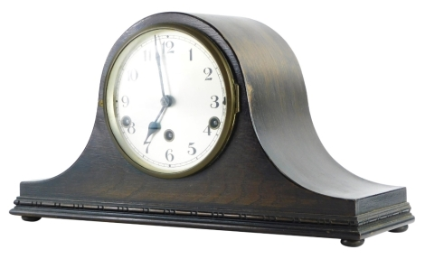A 20thC oak cased Napoleon hat mantel clock, with Arabic numeral dial.