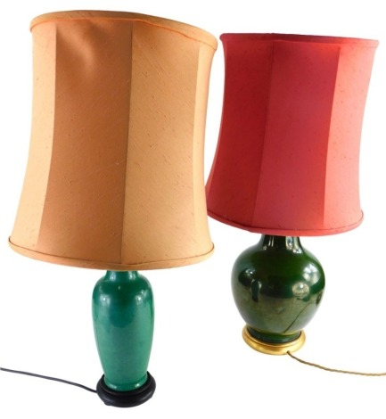 A Chinese style pottery bottle shaped table lamp, in green glaze, 38cm high, and another.