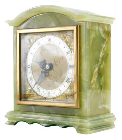 An onyx Elliott clock retailed by Bracher and Sydenham, Reading, with a brass Roman numeric dial, 15cm high.