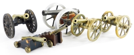 A collection of miniature and other table cannons, to include some brass examples, with match strikes, etc. (a quantity)