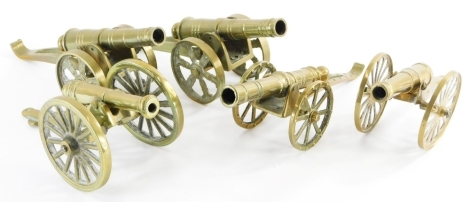 A collection of five brass table cannons, one formed as a match strike. (5)