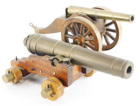 Two brass and treen framed table cannons, one based on a World War One British canon, 33cm long.