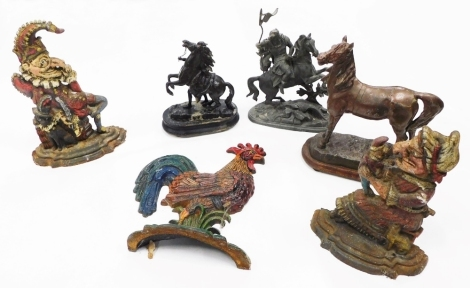 A quantity of metalware, to include spelter Marley horses, spelter figure of Roman soldier on horseback, three cast and painted door stops, etc.