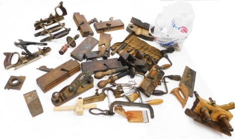 A quantity of wood working tools, to include stamped planes, etc.