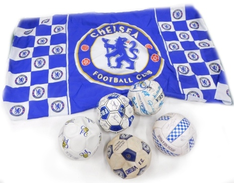 Five Chelsea football club signed footballs, and a flag.