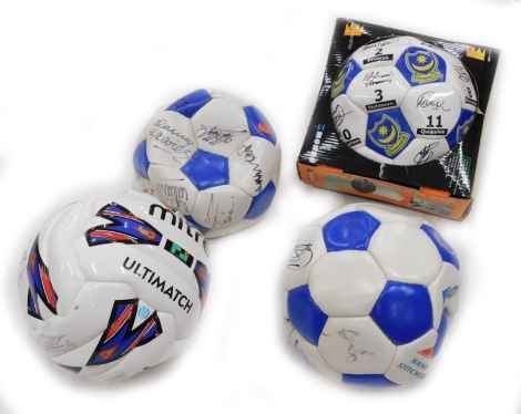 A collection of four signed footballs, to include Portsmouth.