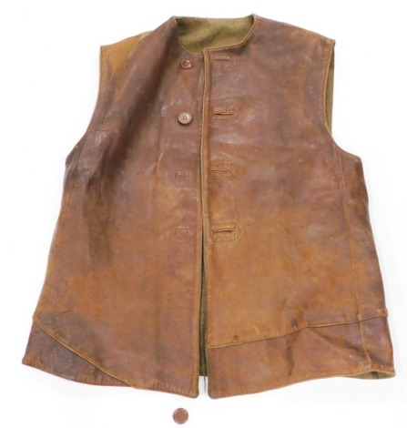 A leather workman's or military sleeveless waistcoat or jacket, with green lining.